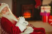 Santa claus relaxing on the couch — Foto Stock