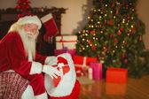 Smiling santa claus stocking gifts  — Foto de Stock