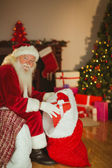 Happy santa claus stocking gifts — Stock Photo