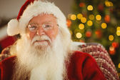 Portrait of happy santa with his glasses — Stock Photo