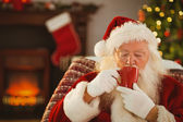 Father christmas drinking a hot beverage  — 图库照片
