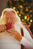 Father christmas drinking hot drink — 图库照片