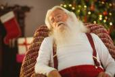 Santa claus sleeping on the armchair — Stock Photo