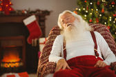 Santa claus napping on the armchair — 图库照片
