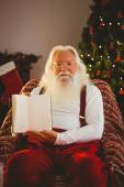 Portrait of santa showing his book — Stock Photo