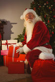 Portrait of santa delivering gifts at christmas eve — Stock Photo