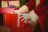 Santa claus delivering presents — Stock Photo