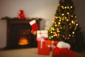 Christmas tree with presents near the fireplace — Stock Photo