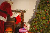 Father christmas stocking gifts at christmas eve — 图库照片