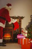 Father christmas stocking gifts at christmas eve — Stock Photo