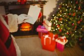 Santa claus holding a paper — Stock Photo