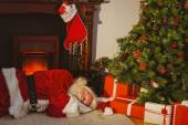 Santa claus napping on the rug — Stockfoto