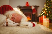 Santa claus resting on the rug — Stockfoto