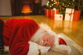 Father christmas sleeping on the rug — 图库照片