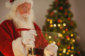 Father christmas writing list on the glass — Foto Stock