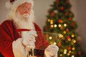 Father christmas writing list on the glass — Fotografia Stock
