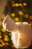 Hand of santa holding engagement ring — Foto Stock