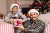 Portrait of smiling father and son at christmas — Stock Photo