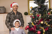Dad and son posing near the christmas tree — Stock Photo