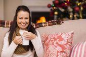 Smiling brunette enjoying hot chocolate  — Stock Photo