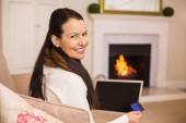 Woman doing online shopping with laptop and credit card — Stock Photo