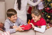 Brother and sister holding a gift — Stock Photo
