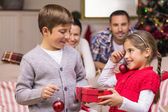 Brother and sister holding gift and baubles — Foto Stock