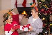 Brother and sister in headband holding present — Stock Photo