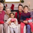 Happy extended family looking at camera at christmas time — Stock Photo #60886177