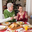 Portrait of happy family toasting at christmas dinner — Stock Photo #60887095