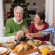 Portrait of happy family toasting at christmas dinner — Stock Photo #60887101