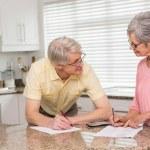 Senior couple paying their bills — Stock Photo #60887709