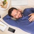 Happy man lying on floor surrounded by his things — Stock Photo #60888561