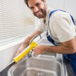 Plumber putting filling in between tiles — Stock Photo #60889909
