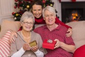 Mother posing with grandparents at christmas — Foto Stock