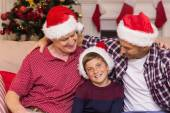 Portrait of grandfather father and son in santa hats — Stockfoto