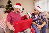 Surprised grandfather opening his gift — ストック写真