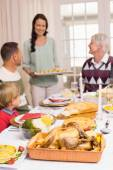 Woman holding christmas dinner with family at dinning table — Stock Photo