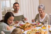 Smiling multi generation during christmas dinner — Fotografia Stock