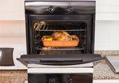 Roast turkey in oven for christmas dinner — Stock Photo