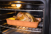 Close up of roast turkey in oven for christmas dinner — Stock Photo