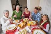 Portrait of happy family toasting at camera — Stock Photo