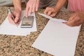 Senior couple paying their bills — Stock Photo