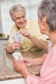 Senior couple playing cards at the counter — Stock Photo