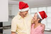Senior couple wearing santa hats — Stockfoto
