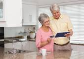 Senior couple shopping online with tablet pc — Stock Photo