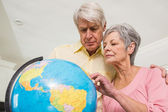Senior couple choosing a travel destination — Stock Photo