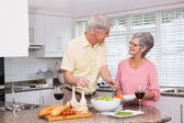 Senior couple preparing lunch together — Stock Photo