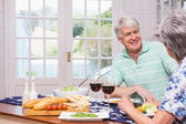 Senior couple having lunch together — Stock Photo