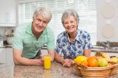 Senior couple smiling at the camera together — Stock Photo